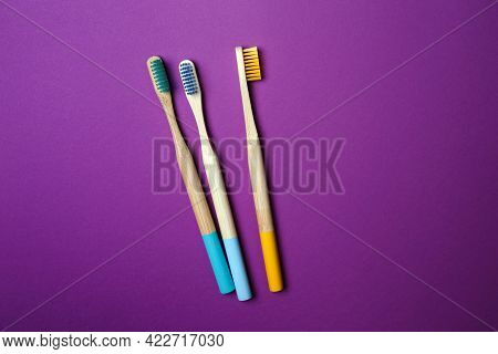 Bright Toothbrushes On A Violet Background