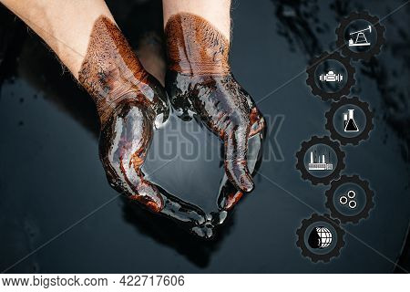 Crude Oil In Hand Due To A Fuel Oil Leak. Process Of Oil Refining. Folded Cups Of Hands With Fuel Oi