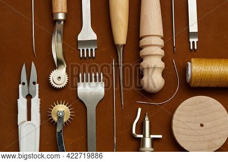 Leather Crafting Tools On The Genuine Leather On The Table, Handicraftsman Equipment For Diy Leather