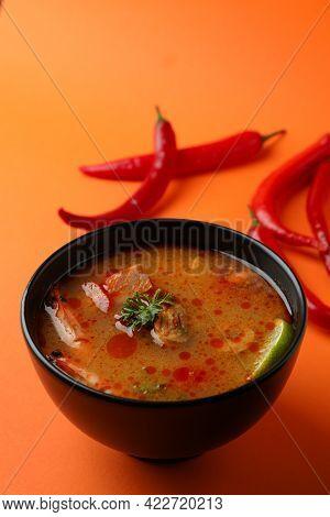 Tasty Tom Yum Soup On Orange Background