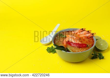 Tasty Tom Yum Soup On Yellow Background