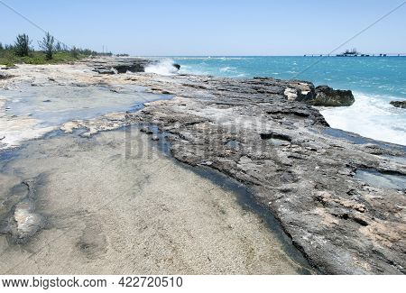 The View Of Wet Eroded Coastline With Waves In A Background On Grand Bahama Island.