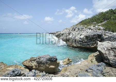 The Scenic View Of Half Moon Cay Steep Rocky Coastline And Turquoise Color Waters (bahamas).