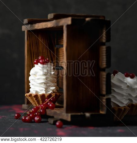 Puffy Creamy Dessert Decorated With Red Berries. Baked Tarts Or Baskets Of Dough With Airy Whipped C