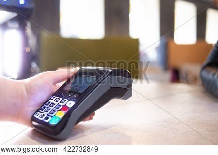 Close-up Of A Salesperson Using Nfs Technology To Pay A Barista For A Purchase At A Cafe. Hand With