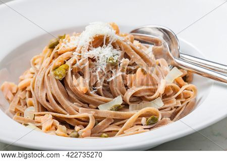 pasta tagliatelle with salmon, capers and parmesan cheese
