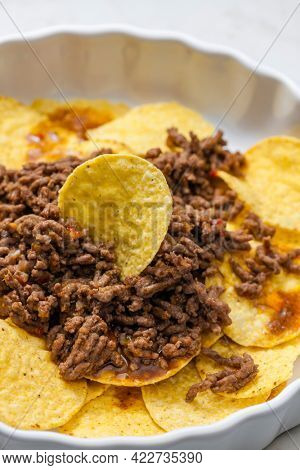 minced beef baked with nachos