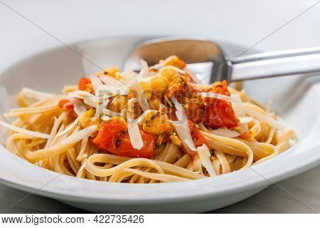 pasta tagliatelle with tomato sauce and chickpeas