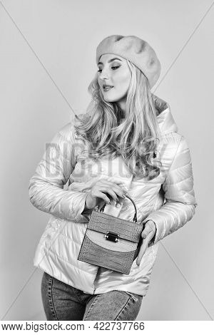 Her Look Is Great. Trendy Girl Holding Small Leather Bag In Hand. Stylish Accessories. Beauty Blondi