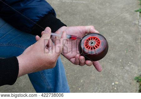 Lubricants In A Syringe In Your Hand