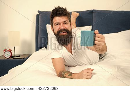 Drink With Relish. Happy Hipster Offer Hot Cup. Pleasure Of Coffee. Bearded Man Give Cup Of Coffee.