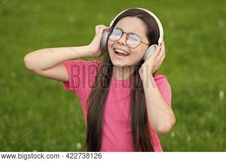 Adding Happiness Through Singing. Happy Singer Sing Song On Green Grass. Little Girl Enjoy Singing I
