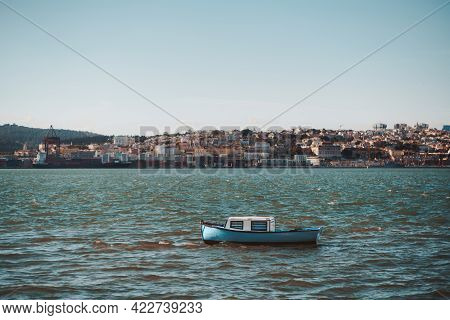 An Old Tiny Cozy Boat With Bluish Striped Curtains Inside Of Its Cabin, Sways In The Waves Of The Ta