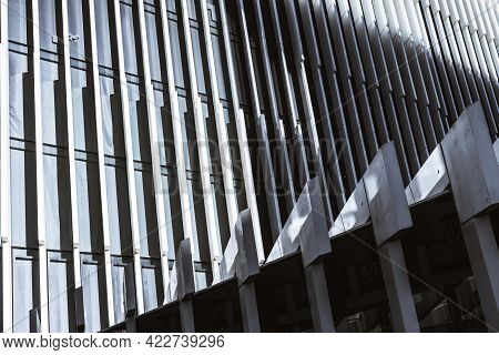 Side View Of An Abstract White Contemporary Business Building Facade With Thick Vertical Soundproofi