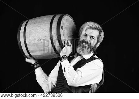 Degustator Man. Sommelier Tastes Expensive Drink. Elegant Waiter Carry Wine. Working In Wine Cellar.
