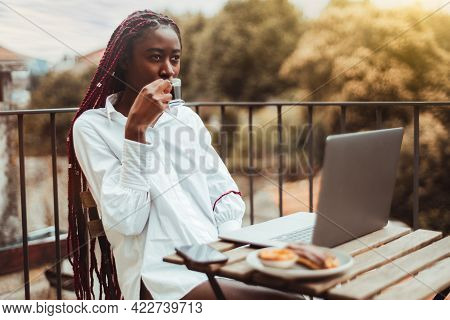 A Morning Portrait Of A Sleepy Young Black Female Freelancer, Drinking A Hot Espresso From A Small C