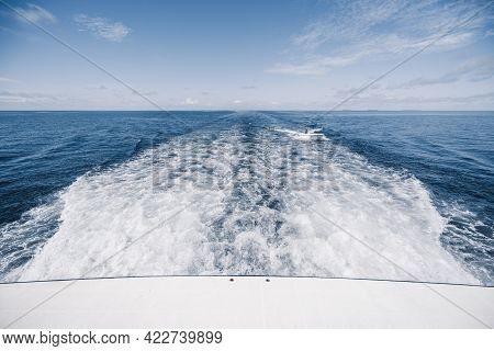 View From The Boat Stern Of The Wake (wash) Effect On The Water From The Motor Placed On The Transom