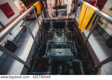 A Wide-angle View Of A Huge Powerful Gasoline Diesel Engine Of A Yacht, Or A Boat, Or A Small Ship,