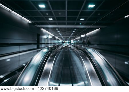 View With A Shallow Depth Of Field Of Two Travelators In A Contemporary Airport With Selective Focus