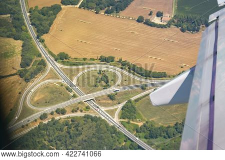 Highway Intersection Of Transport Directions. View From Airplane Above Motorway. Spain July 25 2018.