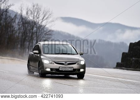 Russia, Sochi, April 18, 2021: A Passenger Car Is Moving On A Mountain Road In Difficult Natural Con