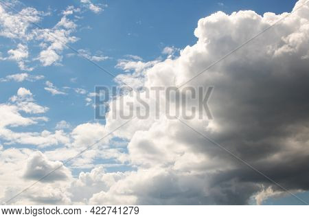 Sunlit Clouds In The Sky And Trees