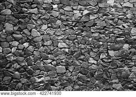 Texture Of Old Rock Wall For Background. Old Grey Stone Wall Background Texture Close Up.