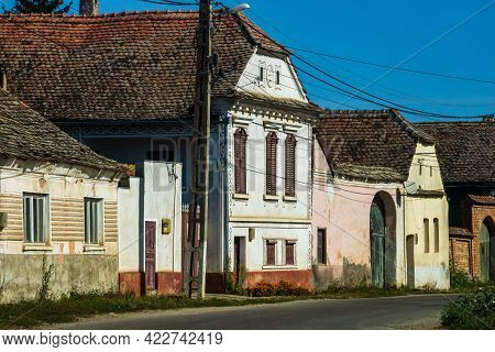 View Of Picturesque Village Viscri In Romania. Painted Traditional Old Houses In Medieval Saxon Vill