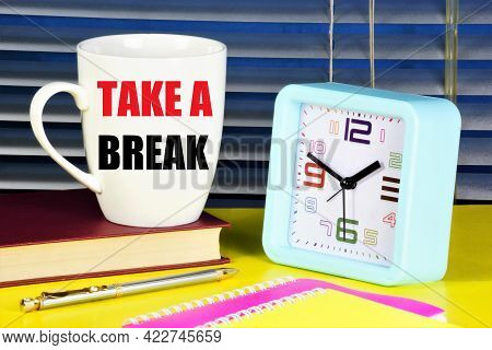 Take A Break. The Inscription On The Cup On The Background Of The Clock. Pausing An Activity To Rela