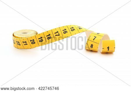 Yellow Isolated Metric Measuring Tape Isolated On White Background. Centimeter, Close-up