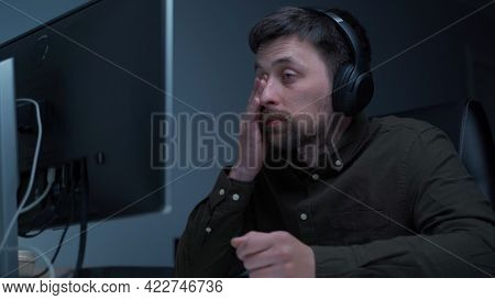 Young Caucasian Man Working Overtime At Computer And Eye Fatigue From Monitor In Home Office. Male H