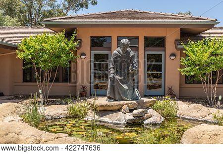 Santa Inez, Ca, Usa - May 26, 2021: San Lorenzo Seminary. Bronze Saint Francis Statue Behind Its Sma