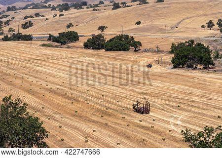 Santa Inez, Ca, Usa - May 26, 2021: San Lorenzo Seminary. Automated Hay Bale Pickup By Special Tract
