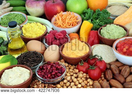 Vegetarian food for a healthy high fibre diet high in protein, omega 3, vitamins, minerals, antioxidants, anthocyanins and fibre. Vegetables, fruit, olive oil, legumes, dips, black tea, and dairy.