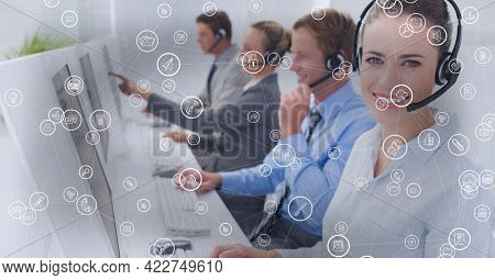 Composition of network of connections with icons over businesswoman using phone headset in office. global business, connections, data processing and technology concept digitally generated image.