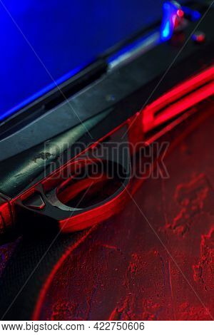 Hunting Shotgun On Black Background With Red And Blue Backlight