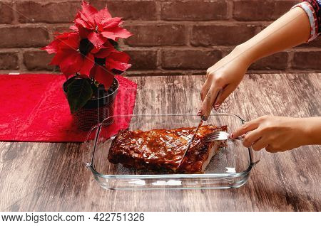 Roasted Ribs Marinated With Barbecue Sauce On Wooden Table.