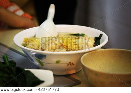 Popular Cantonese Cuisine Shrimp Wonton Noodle Soup Served In Local Hong Kong Eatery.
