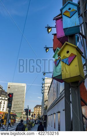 Copenhagen, Denmark - Oct 21, 2018: Colorful Wooden Bird Breeding Boxes Or Nests On A Pole Along  Be