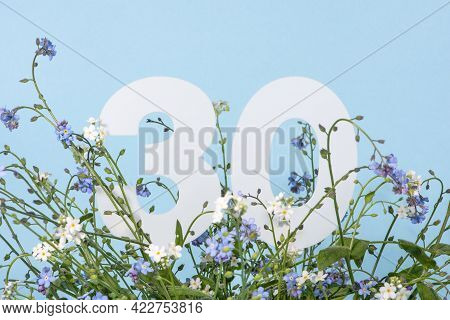 Number Thirty Among Blue Forget-me-not Flowers.  Birthday, Anniversary, Jubilee Concept. For Invitat