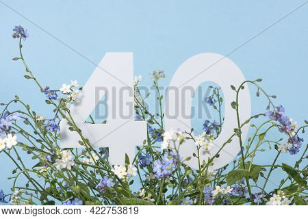 Number Forty Among Blue Forget-me-not Flowers.  Birthday, Anniversary, Jubilee Concept. For Invitati