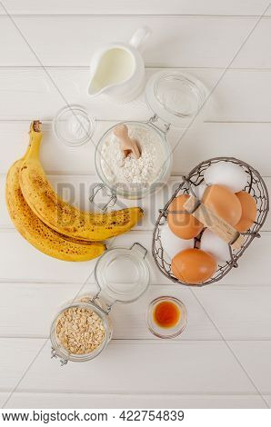 Ingredients For Cooking Oatmeal Pancakes With Bananas. Eggs, Oatmeal, Bananas, Buttermilk, Flour, Va