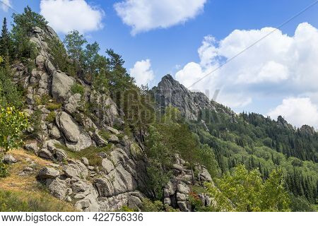 Unusual Rocks In The Mountains. Nature Of Mountain Kolyvan. Mount Sinyukha. Altai Krai, Siberia, Rus