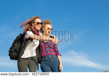 Two Beautiful Girls Are Traveling In The Mountains Hiking In The Mountains