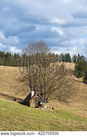 Wooden Cottage, Big Fatra Mountains, Slovak Republic. Seasonal Natural Scene. Travel Destination. Hi