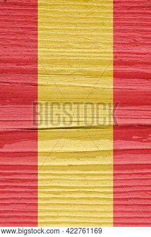 Flag Of Spain On Dry Wooden Surface, Cracked With Age. Vertical Background, Wallpaper Or Backdrop Wi