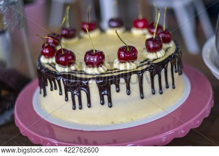 Chocolate Cheese Cake With Cherry On Top