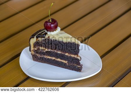 Slice Of Chocolate Cheese Cake On White Plate