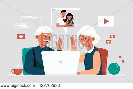 Grandparents communicate via video link with their families. Older couple enjoying each other. The concept of online communication through the Internet and a video camera in a laptop. A call to grandparents during quarantine and isolation