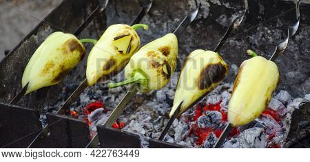 Bell Pepper On A Skewer Preparing To Be Grilled On Charcoal Closeup Blurred Background. Vegetables O